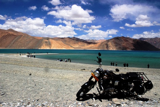 The Royal Enfield at the Pangong Tso lake .. the legend meets another ..