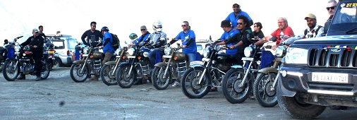 The bikers of the ride line up at Hunder sand dunes. An awesome landscape in the high altitude.
